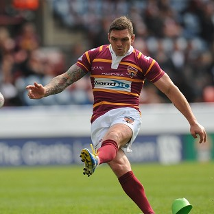 Danny Brough's late goal secured a draw for Huddersfield against Warrington