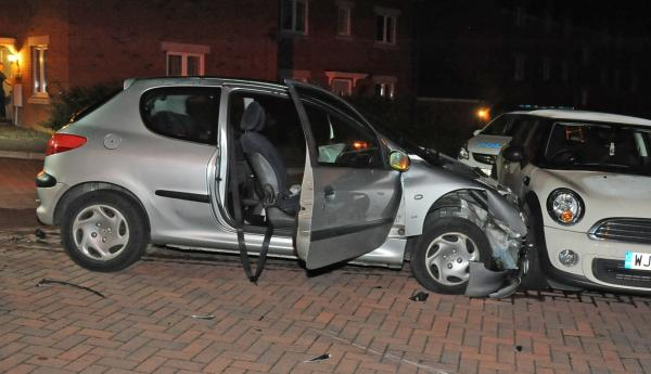 The Peugeot which rolled into the stationary Mini following a collision with a Fiat 500 on Thestfield Drive, Staverton. Picture by Trevor Porter
