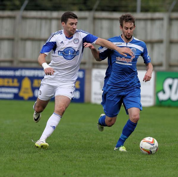 James Guthrie (right) attempts to hold off Hungerford Town's former Bluebird Ian Herring during yesterday's defeat (Picture: Chippenham Town)