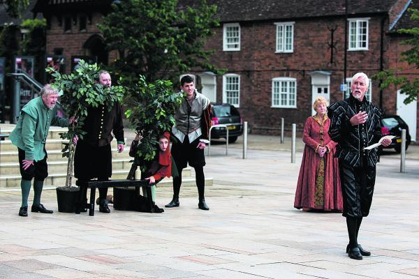 Shakespeare Live actors stayed dry when they played on the streets of Stratford upon Avon