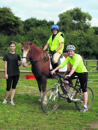 Jo Rutherford on the horse Chesney, Kady Chatman on the bike with Jo's Daughter Holly