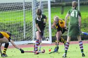 Amanda Robson (green) in action for West Wilts Ladies against Bournemouth