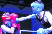 Trowbridge's Harry Bryant (red) is on the end of a punch from Luke Saward, of Downend ABC