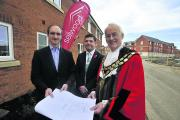 Trowbridge mayor Glyn Bridges with  Selwood Housing's chief executive Barry Hughes and development director Paul Walsh (centre) taking a look at the latest phase of the Castlemead estate, where Selwood is building 146 affordable homes Photo: Glenn Phill