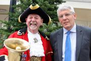 Warminster town crier Phil Seddon and centre manager Peter Ruscoe at The Three Horseshoes Walk shopping mall in Warminster