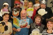 Author Neil Griffiths with his latest children's book The Jolly Dodger with Wiltshire Scrapstore staff as pirates. Picture by Trevor Porter