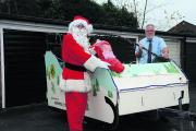 Lion's Santa, Peter Cook, with Lion Richard Lovelock and the sleigh preparing for the Christmas appeal run