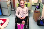 Kitty-Boo Cox in hospital wearing her bright pink casts