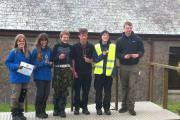 John of Gaunt's successful team celebrate with their medals after completing the 35-mile trek