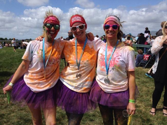 Laura Lockwood, centre, with her sisters Clare Gooding, left, and Louise Gooding, right, after completing the Bath Colour Obstacle Rush