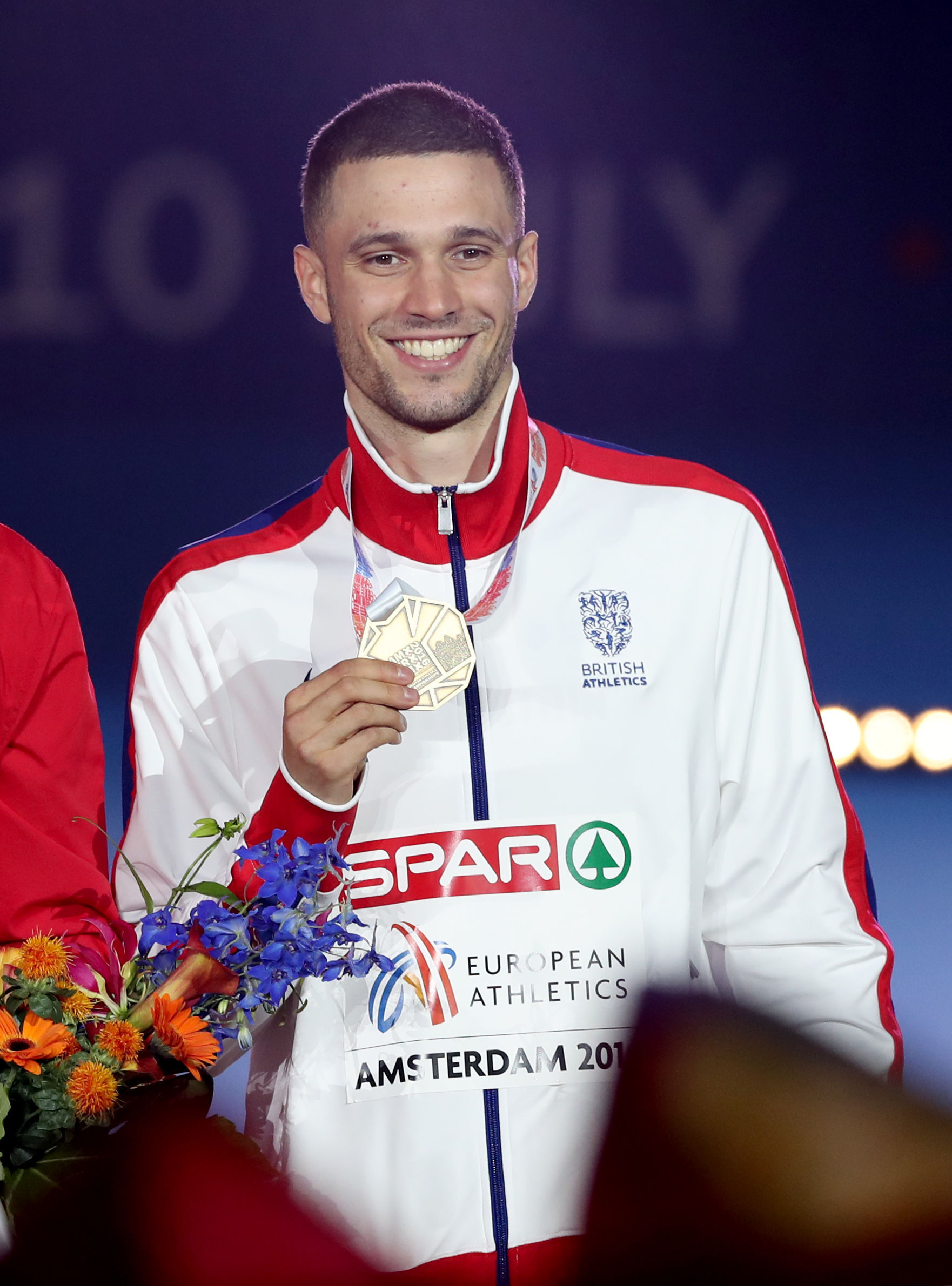 Danny Talbot celebrates with his medal
