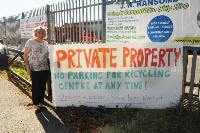 Private Property sign. Clair Davies with the Private Property sign she has had to erect near the recycle  centre.. Pics Trevor Porter 52236 1.