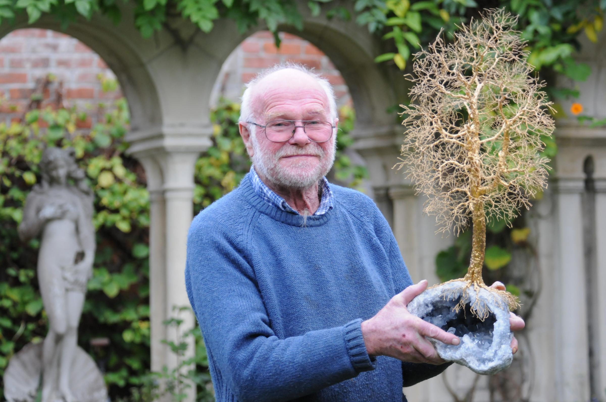 Trowbridge artist Patrick Drinkwater with one of his gold tree sculptures. Pic Trevor Porter