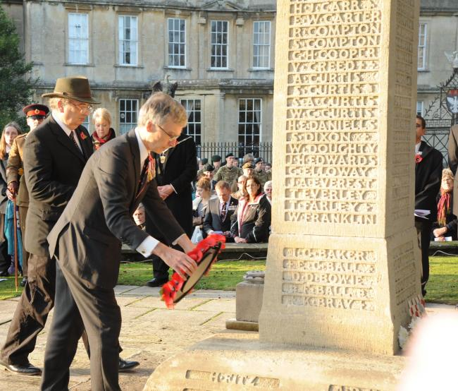 South Wiltshire MP Andrew Murrison lays a wreath at the war memorial in Warminster