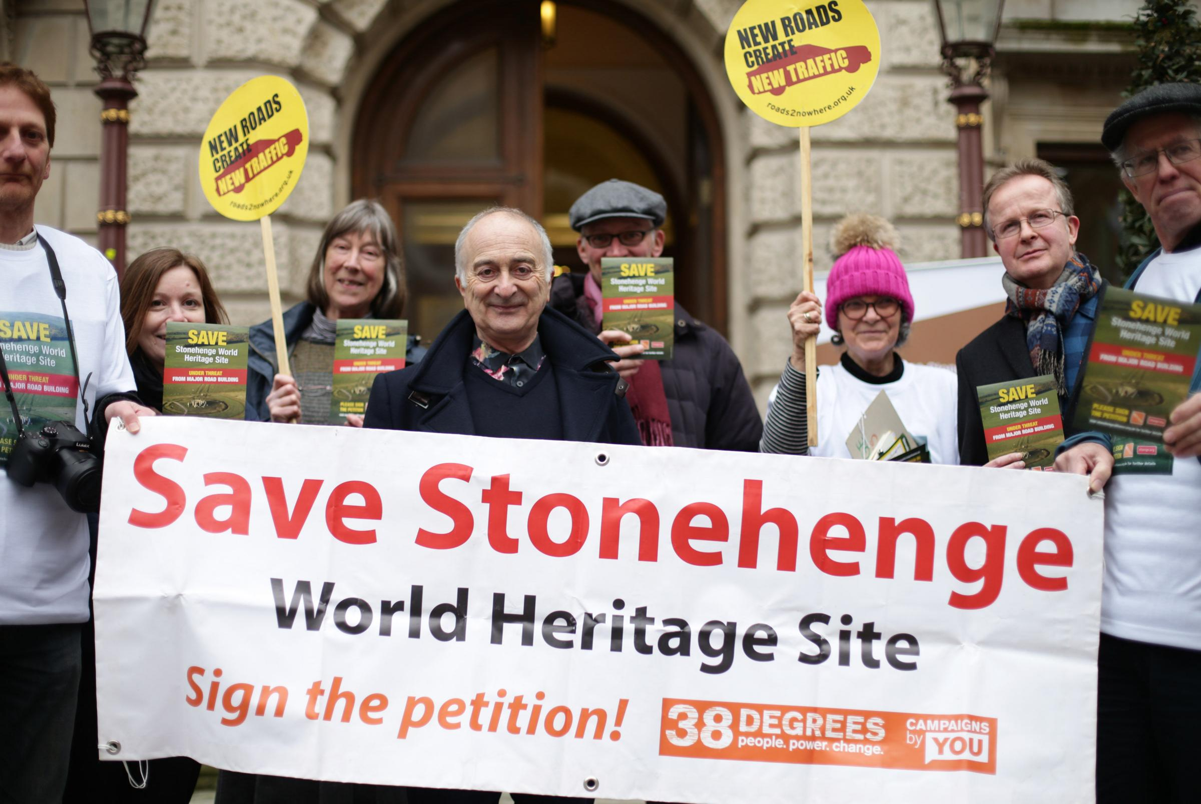 Time Team presenter Tony Robinson, centre, and members of Stonehenge Alliance protest against road building plans for the Stonehenge World Heritage Site, outside the Society of Antiquaries, Burlington House, London. Picture: Yui Mok/PA Wire
