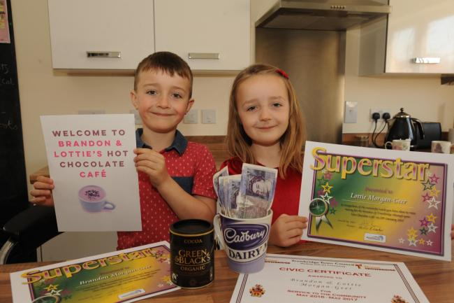 Brandon and Lottie proudly show off their certificates. Pic Trevor Porter