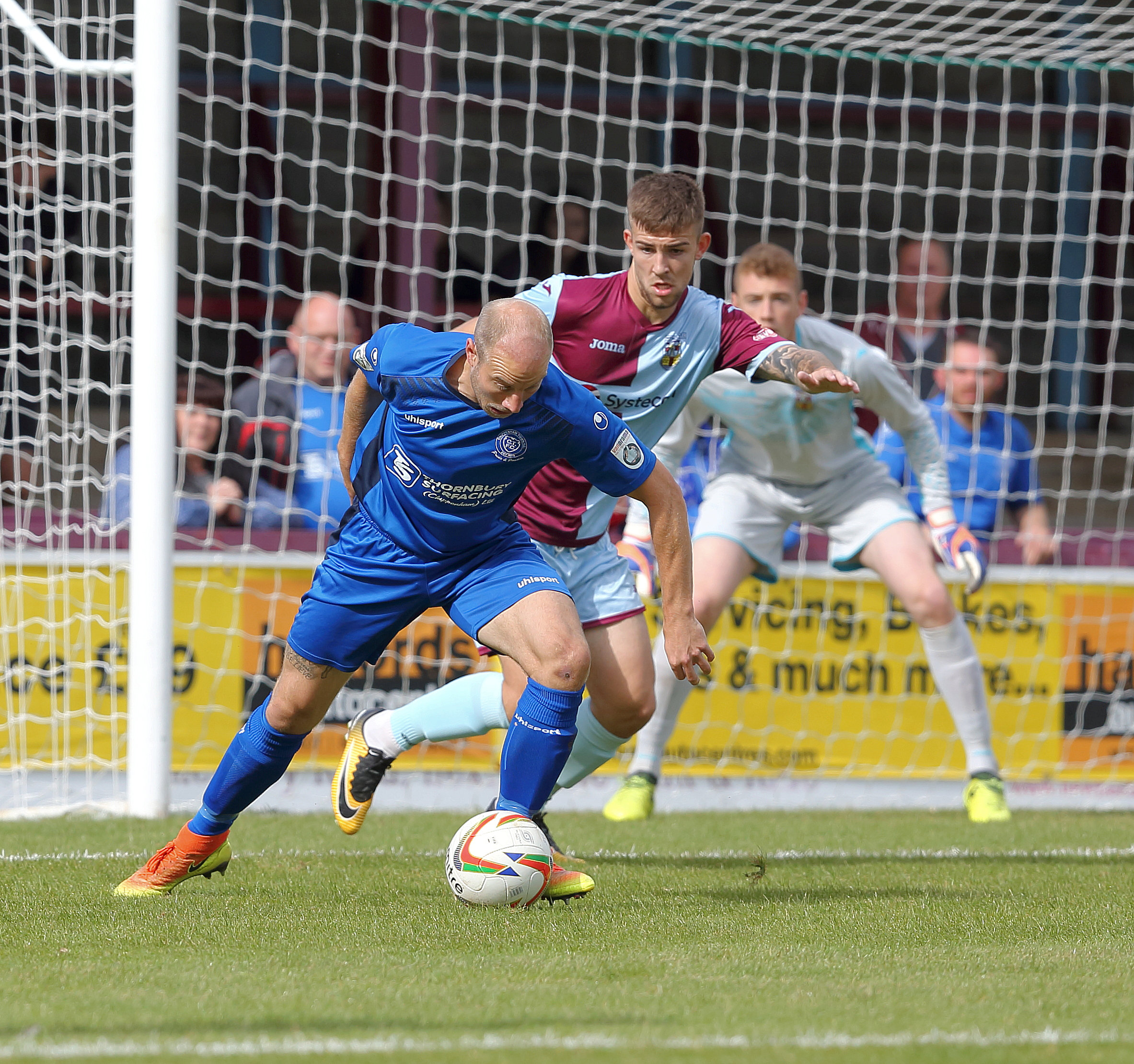 Chippenham Town's Dave Pratt (blue) in action at Weymouth. PICTURE: RICHARD CHAPPELL