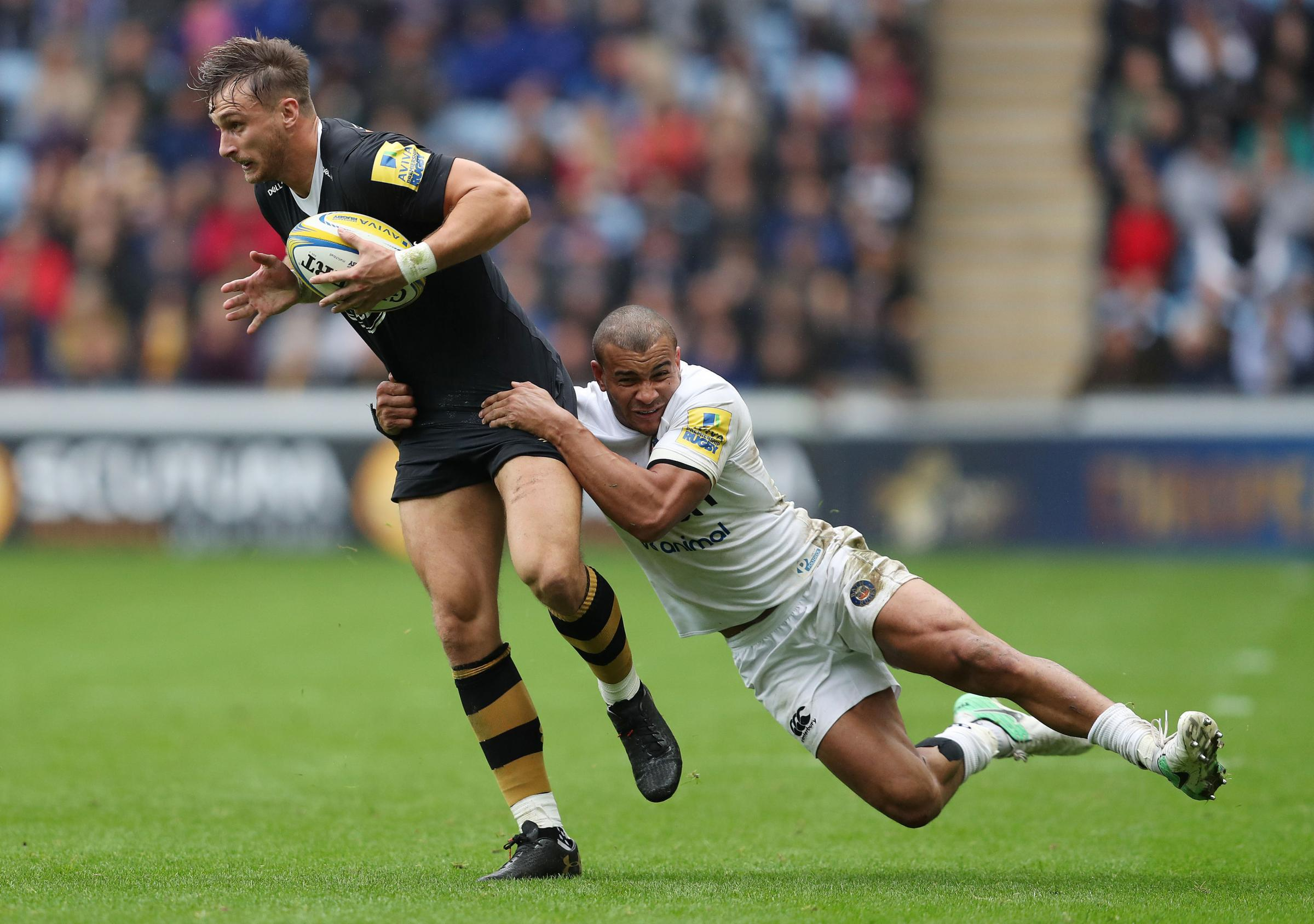 Wasps Josh Bassett is tackled by Bath's Jonathan Joseph