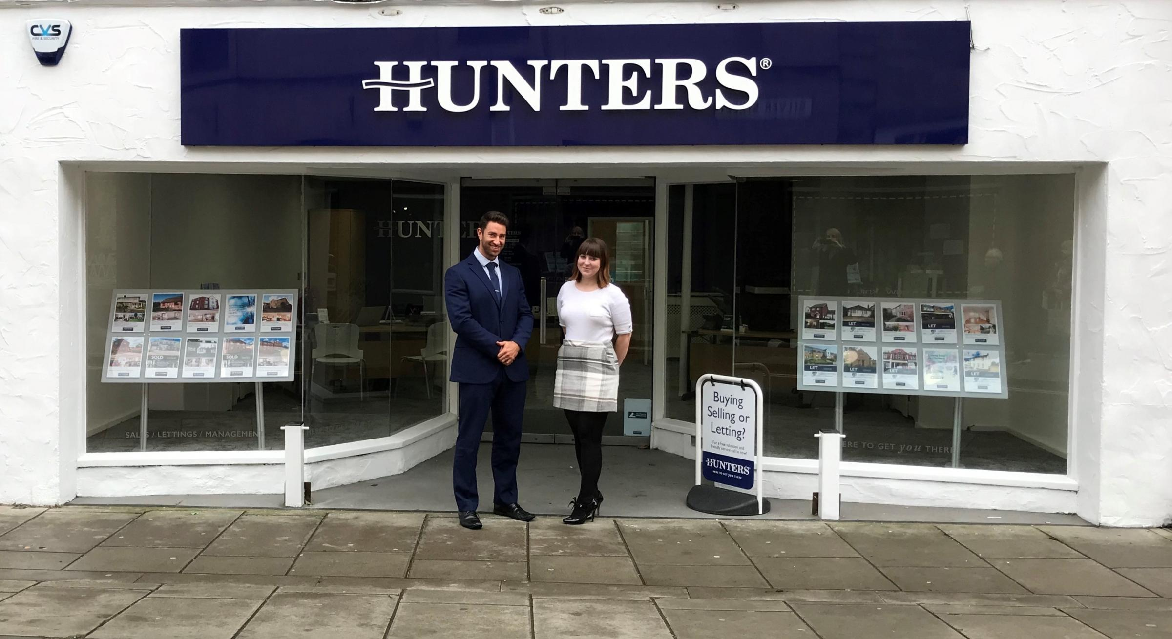 Lewis Sinden, branch manager, and Emma Harvey, sales negotiator, outside the new branch