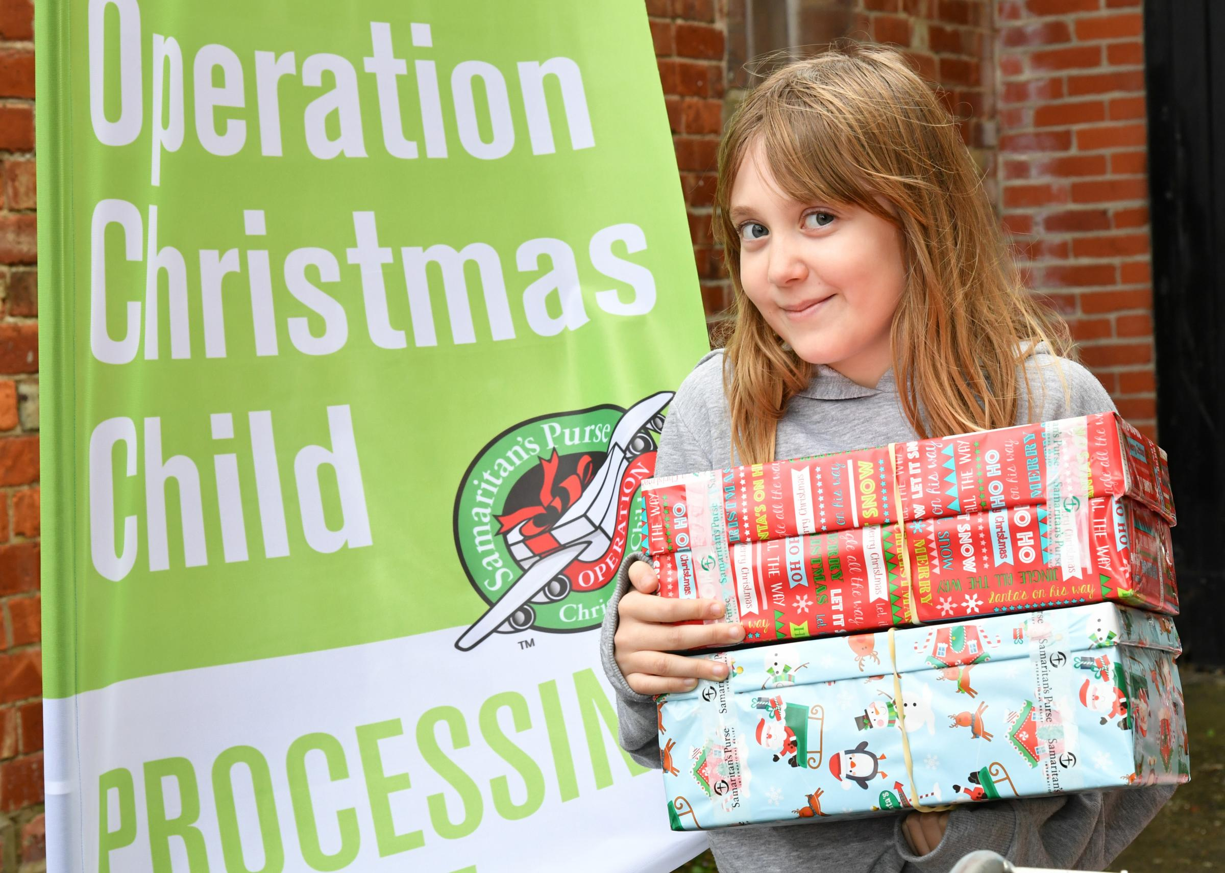 Starting the annual Operation Christmas Child campaign at the Old Silk Factory in Warminster was 10 year old Katie Portsmouth. Photo: Paul Stallard PS006.2.ends.