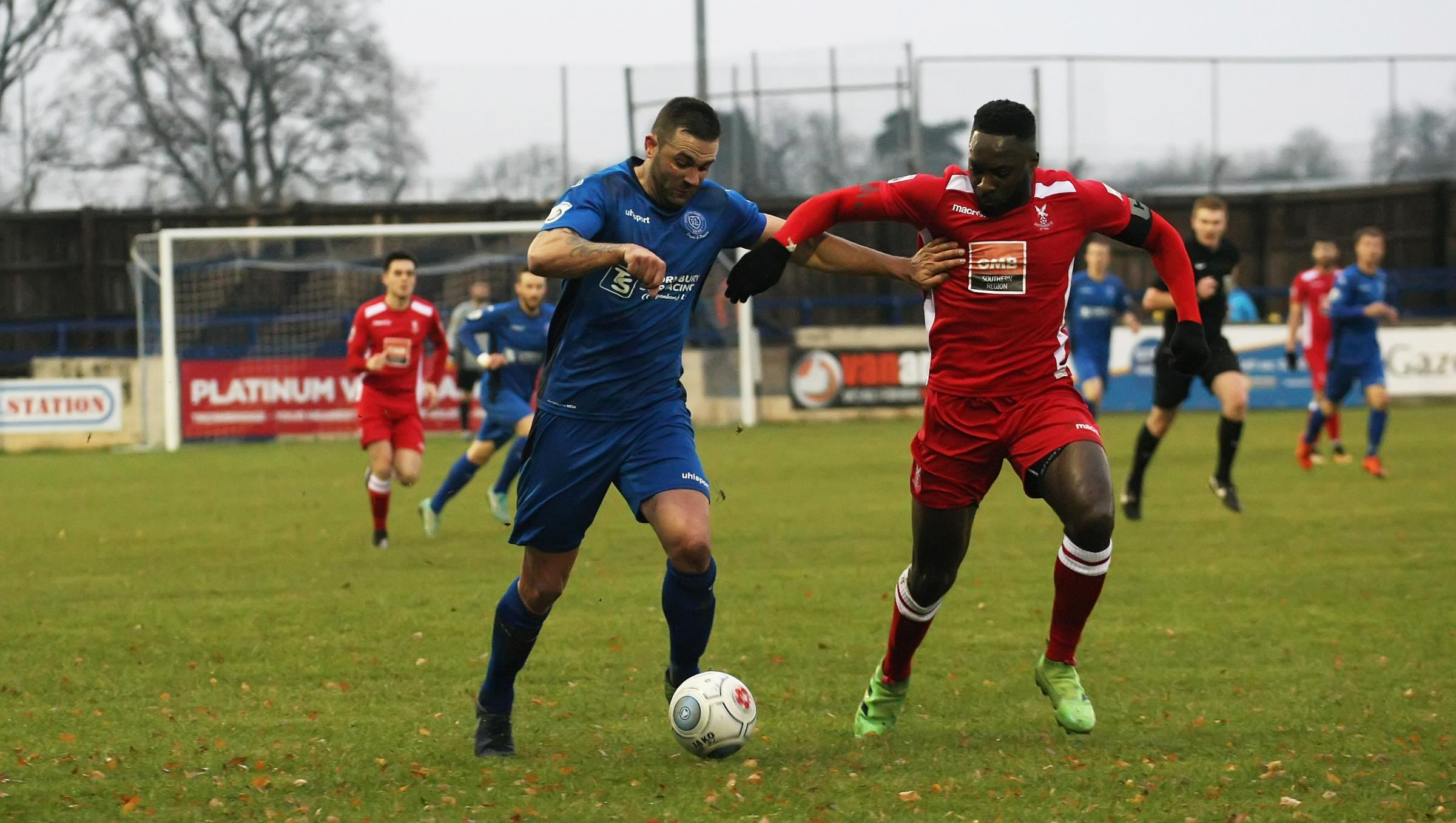 Chippenham Town striker Andy Sandell (blue) looks to cause problems for the Whitehawk defence during his side's 2-1 home victory in National League South on Saturday. PICTURE: ROBIN FOSTER