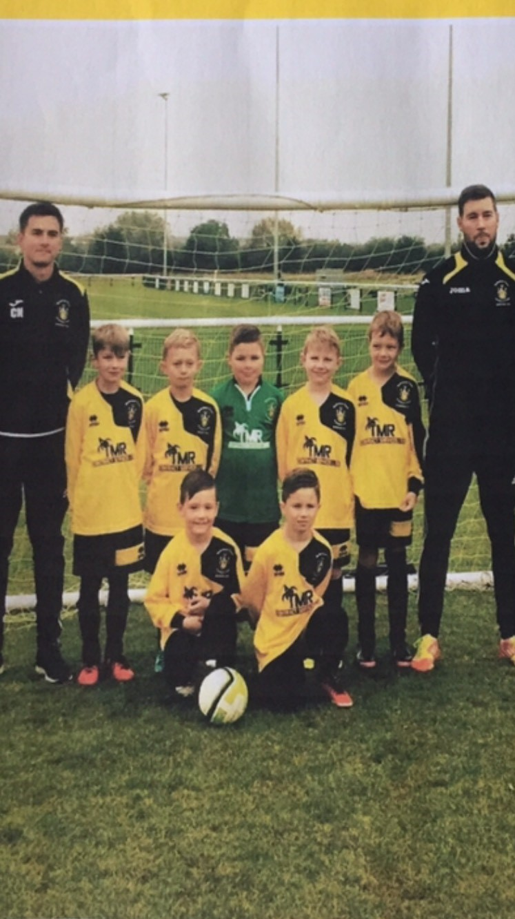 Melksham Town FC Hurricanes U8s with manager Tom Crawford and assistant coach Craig Neate.