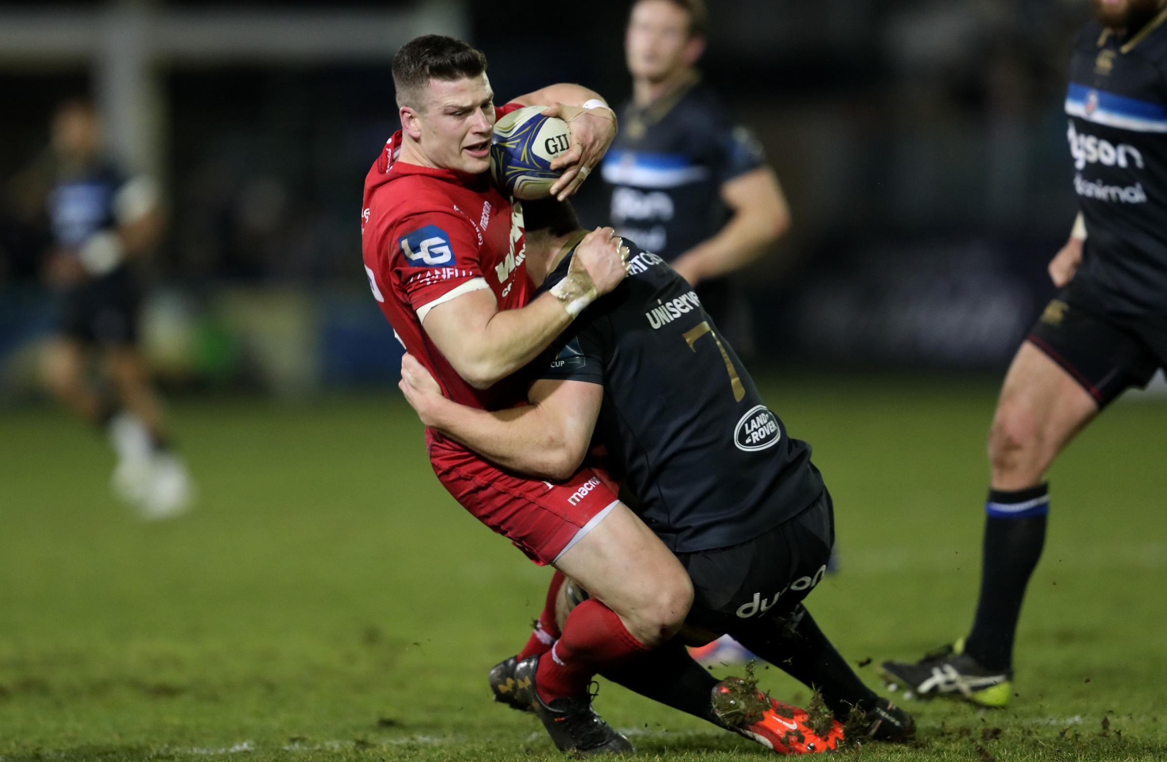 Llanelli Scarlets Scott Williams is tackled Bath's Sam Underhill