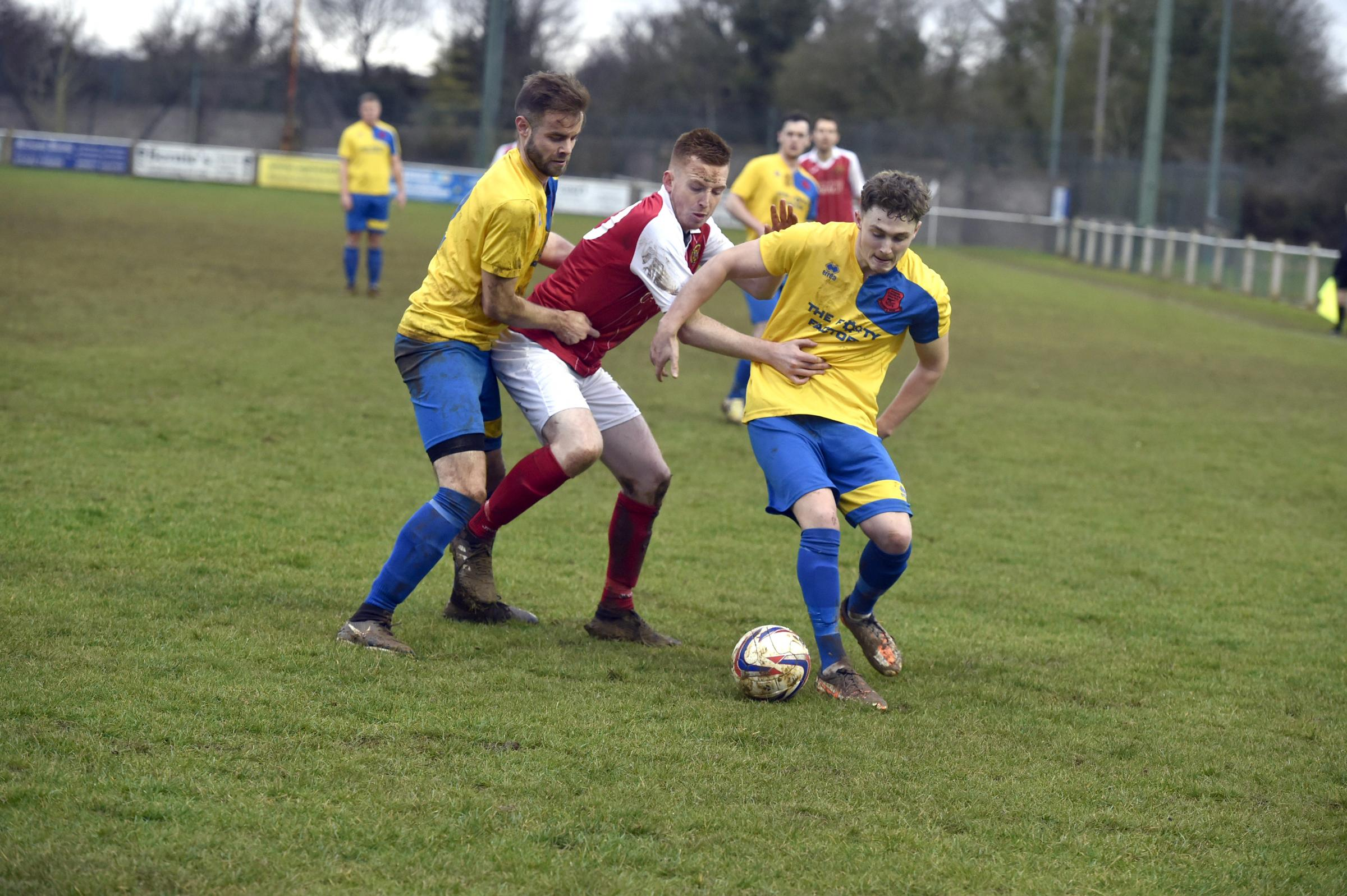 Corsham Town's Leigh Rogers (yellow) on the ball against Bishops Lydeard at the weekend. PICTURE: DIANE VOSE