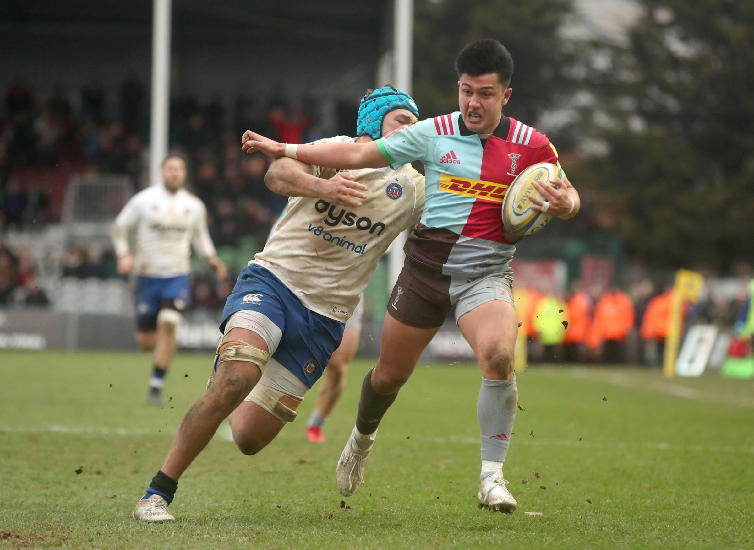 Harlequins' Marcus Smith is tackled by Bath's Zach Mercer