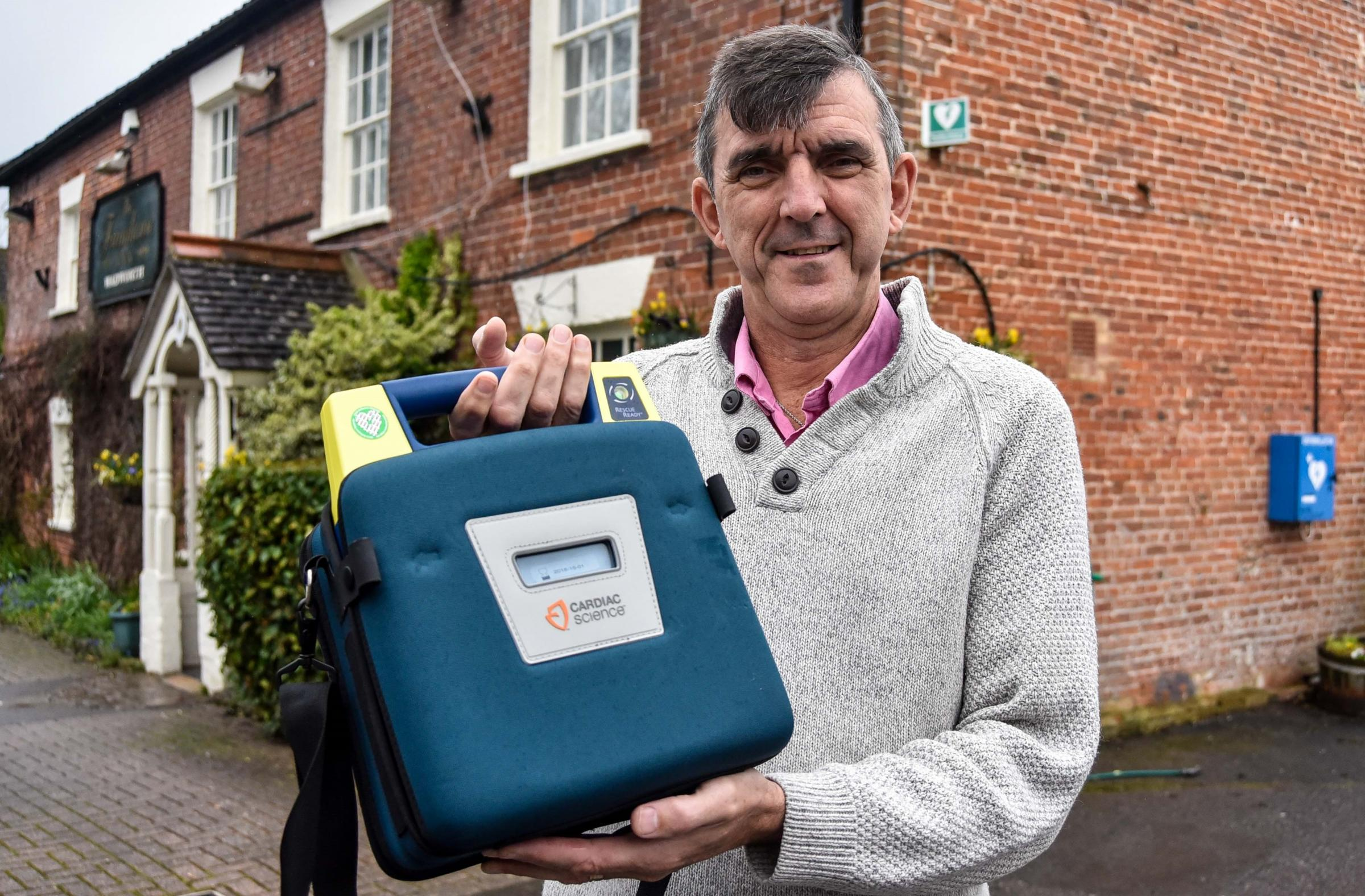 Adam Glass, landlord of the Farmhouse Inn, Southwick, with the old  defibrillator that needs replacing. The pub has raised £800 so far towards a £200 target.  Photo by www.gphillipsphotography.com GP1272