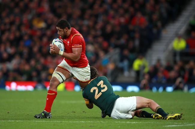 Wales' Taulupe Faletau (left) looks to break through the tackle of South Africa's Jan Serfontein during the Rugby World Cup game at Twickenham Stadium, London..