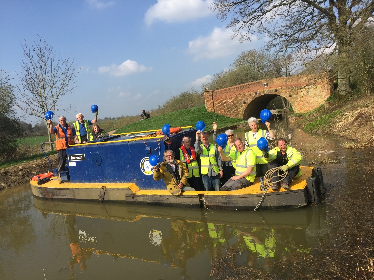 Wilts & Berks Canal Trust members from Melksham, Chippenham & Calne Branch aboard Boswell in front of Double Bridge. Photo: Justin Guy.