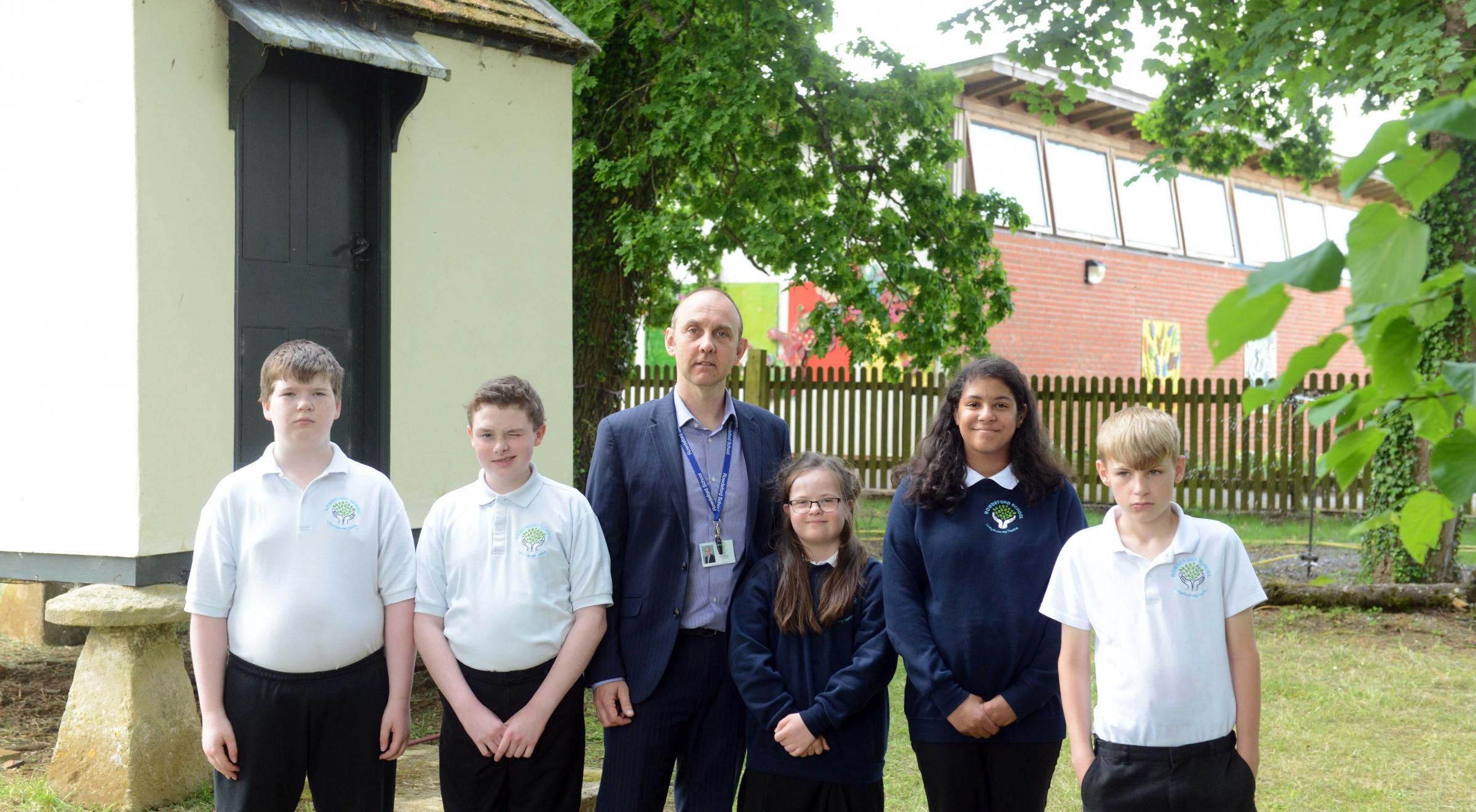 Rowdeford School under threat of closure.  Photo: Siobhan Boyle SMB2433/2..Pictured with head teacher Mike Loveridge are pupils l-r Sam, Isaac, Laura, Aliyah and Nathan.