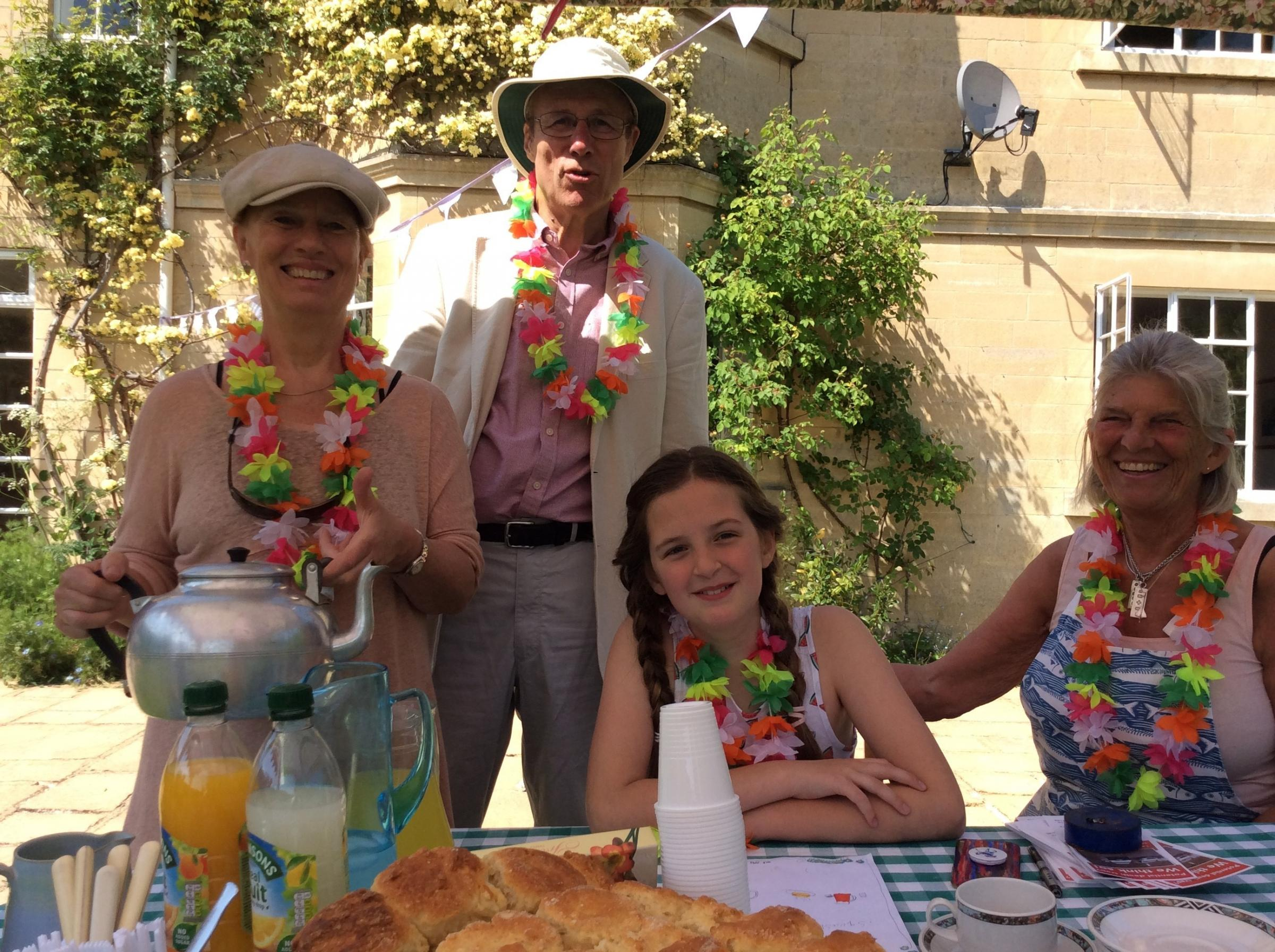 Dr Trisha Waters and Mike Daniel, of Winsley Hill Traffic Action Group, with Asha Fitzsimmons, 10, and Judy Spence, serving the cream teas to raise funds. Photo: John Baker