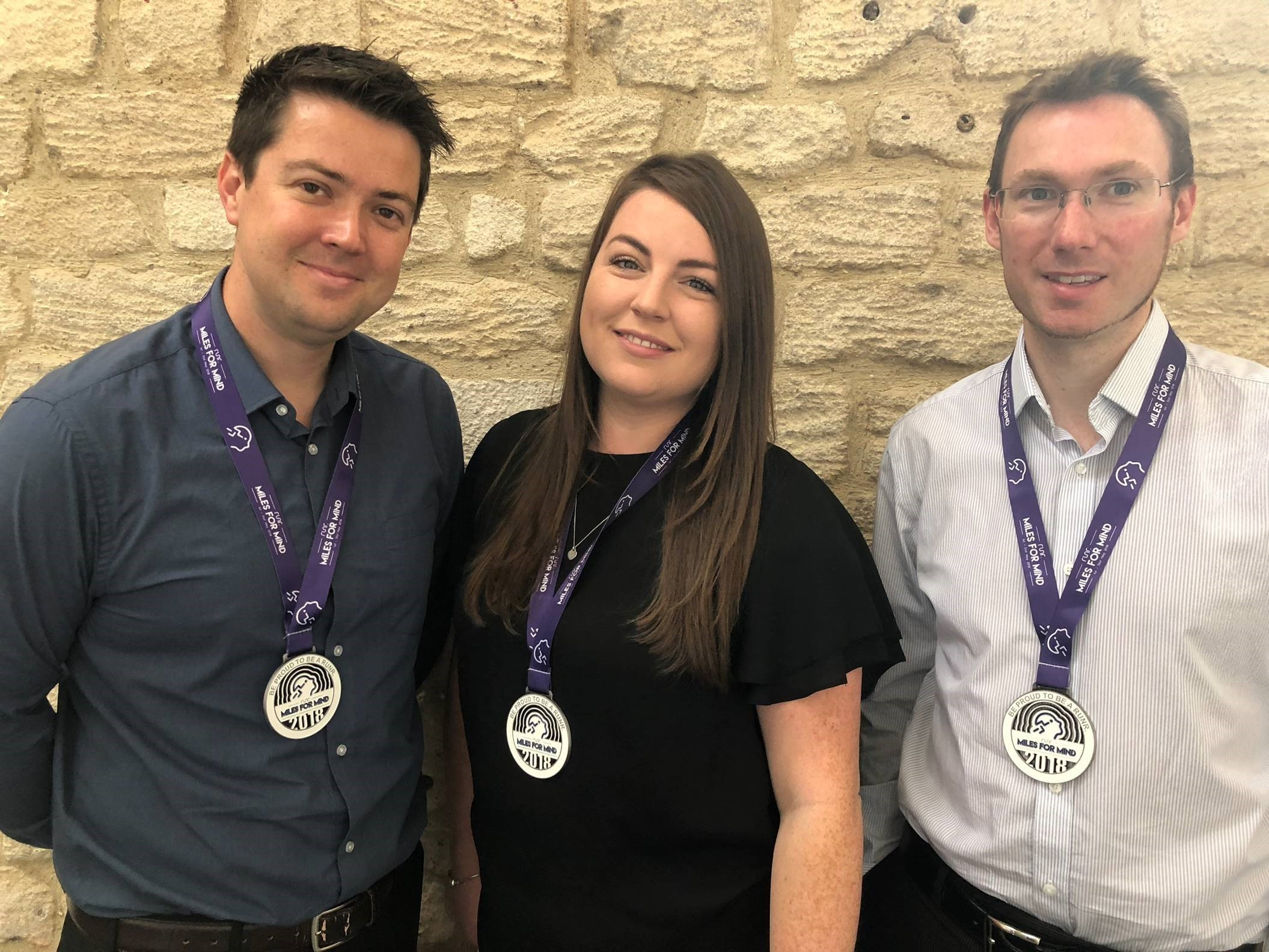 Mark Salen, Harriet Brooks and James Eades with their Miles For Mind medals.