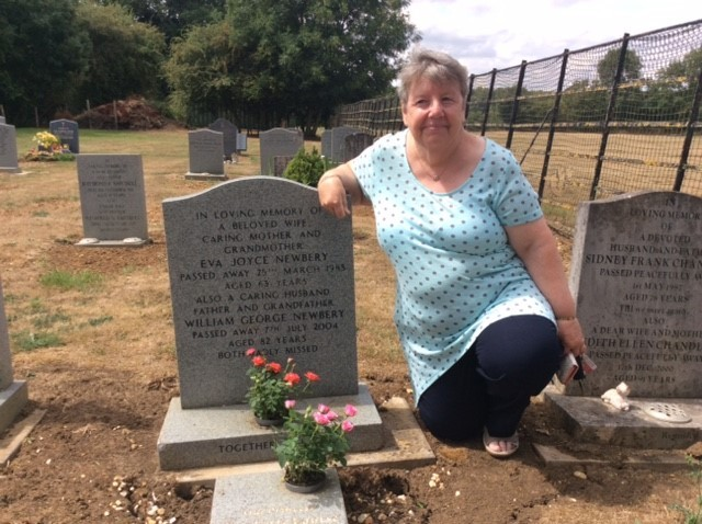 Sandie Chaddock by the graves of her parents and grand-daughter