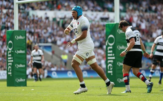 England's Zach Mercer celebrates scoring his sides third try during the Quilter Cup match between England and the Barbarians at Twickenham Stadium, London.