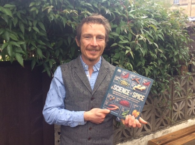 Dr Stuart Farrimond with his latest book, The Science of Spice