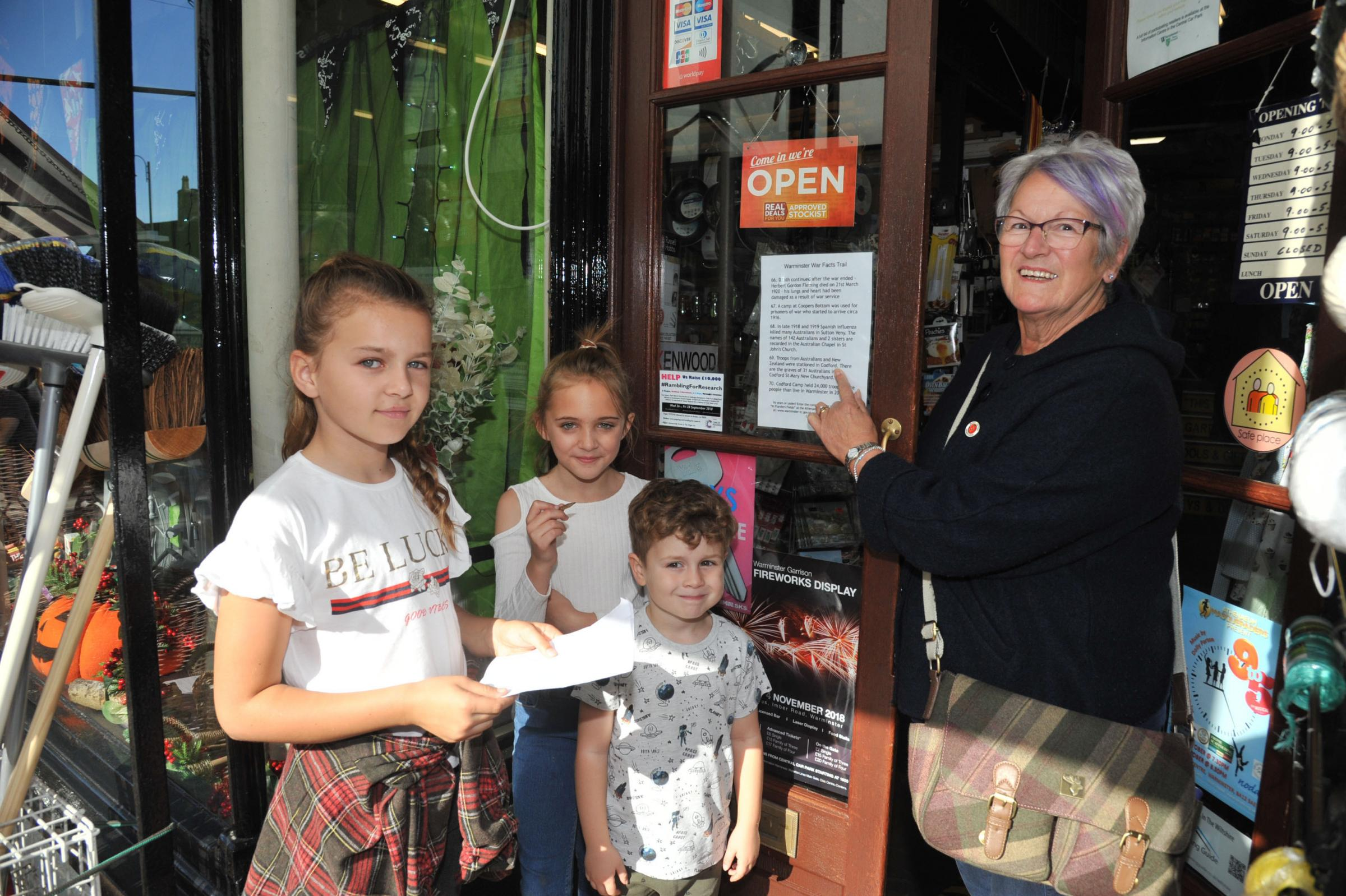 Lesley Fudge, a Warminster Poppy Appeal fundraiser, promotes her WWI fact-finder trail with youngsters Maddy, Grace and Archie              Photo: Trevor Porter 59970-1