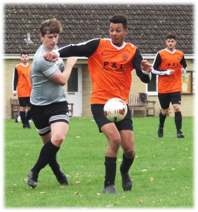 Action from the 5-0 win for FC Libby (orange) over Westbury Railway. PICTURE: CADER ESOOF