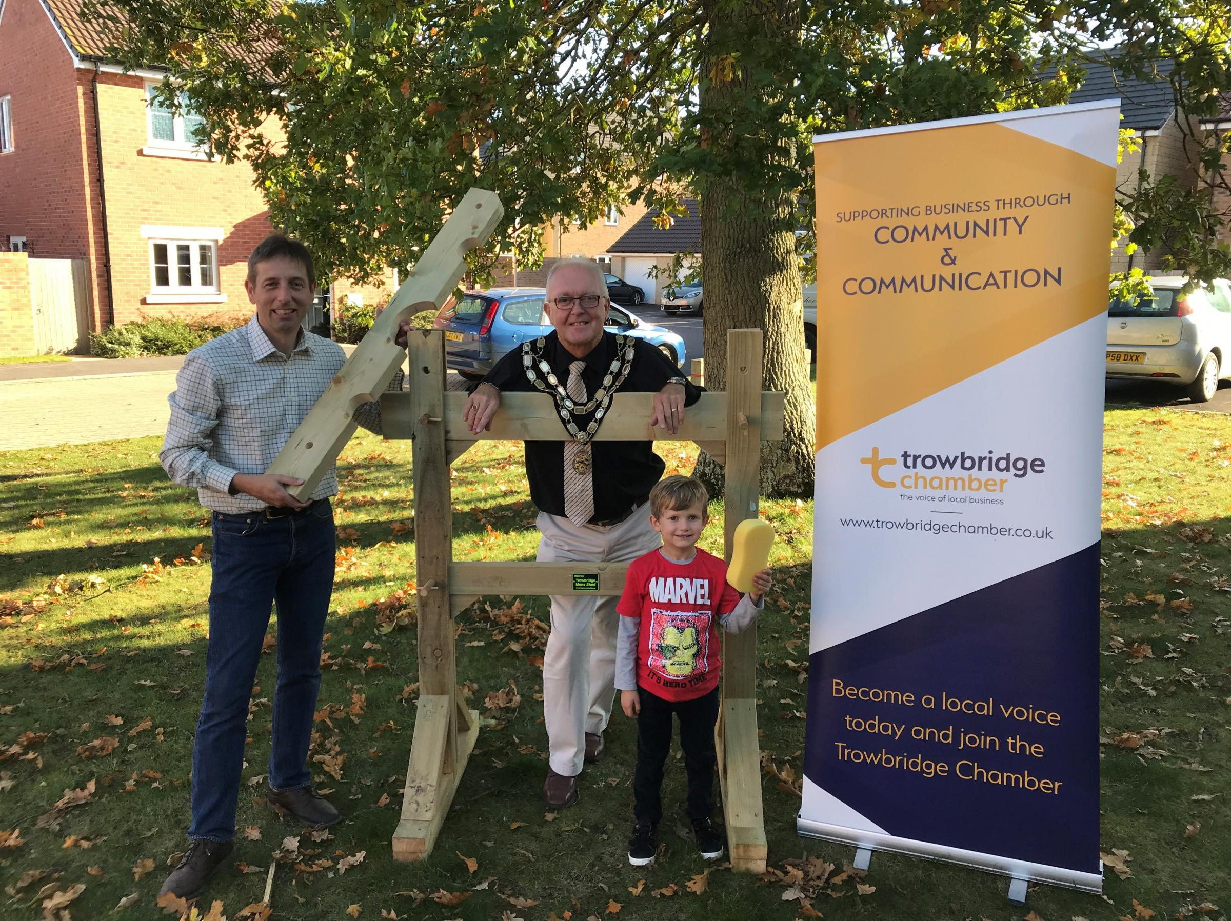 Cllr Dennis Drewett, the Mayor of Trowbridge, with Edward Kirk, of Trowbridge Chamber, and Henry Hawker, 4