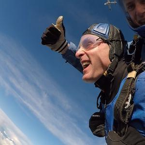 Chief Constable Kier Pritchard gives the thumbs up during his skydive