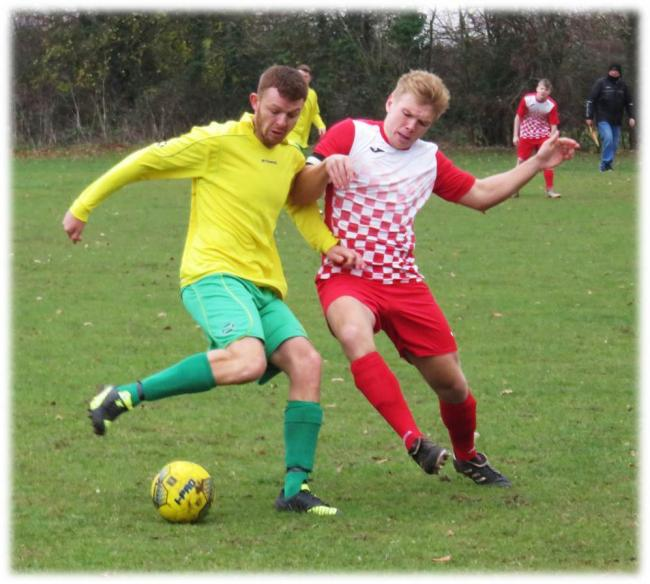 Action from the clash between AFC Melksham (yellow) and Box Rovers. PICTURE: CADER ESOFF