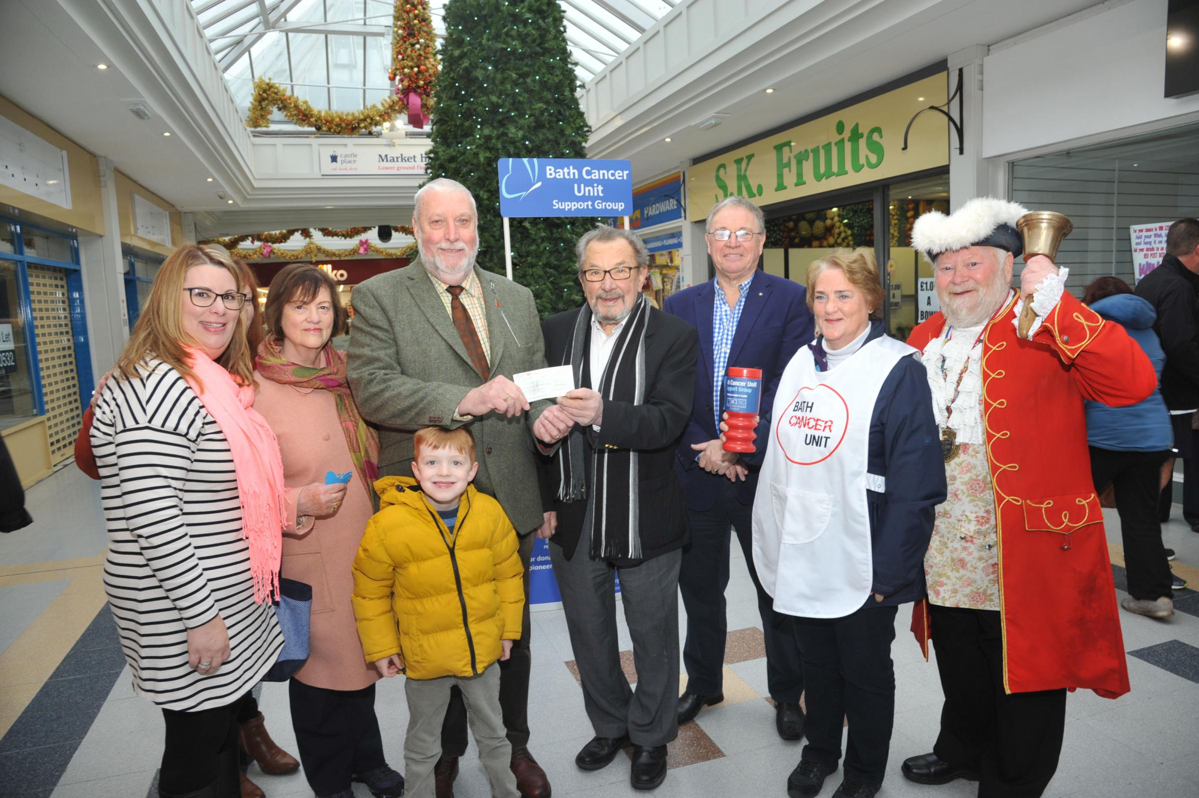 Chairman of cancer support group Trowbridge , Tino Polledri receives the Cheque from Nigel Hunt and family. Photo Trevor Porter 60061 1..