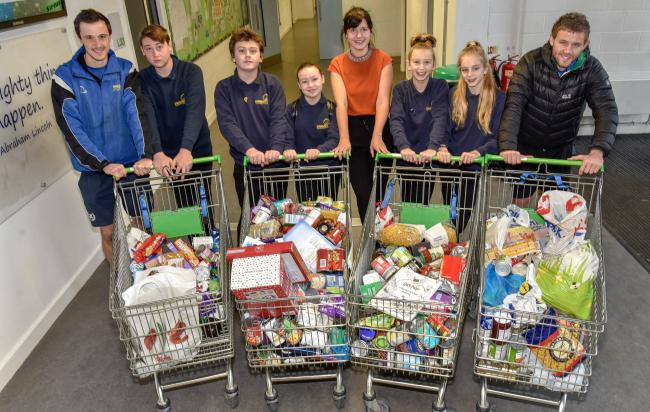 Melksham Oak School staff, Michaela Hyne, Callum Hurn and Callum Wolff with pupils Lewis Henley-Francis, Cally Parfitt, Tyler Bennett, Abby Tucker and Brook Rockley with the food bank collection. Photo by www.gphillipsphotography.com GP 1527