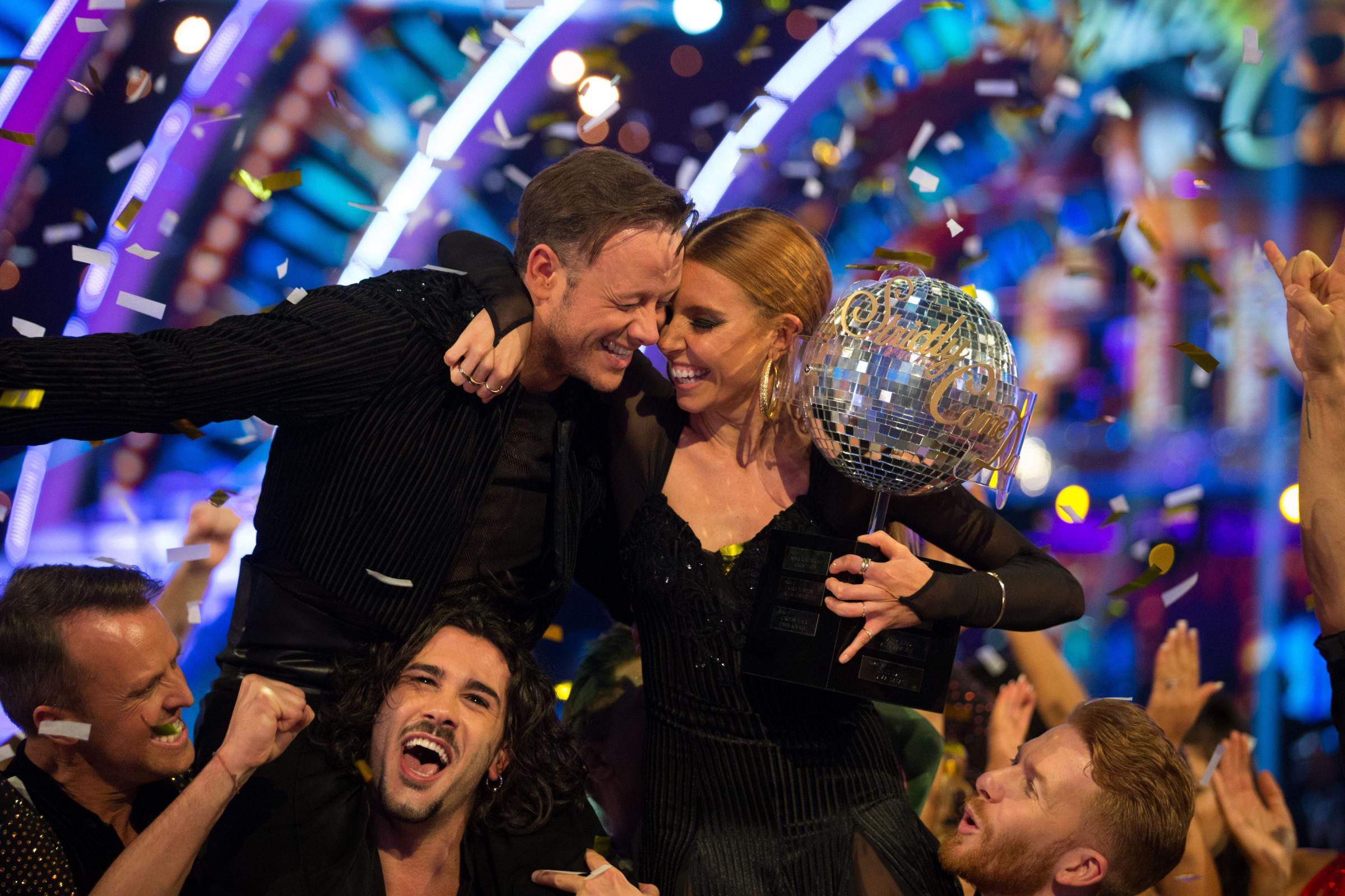 Kevin Clifton and Stacey Dooley celebrate with the glitterball trophy