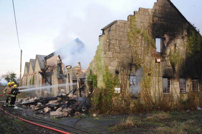 Firefights battling the blaze at Neston in the former glove factory in the village. Photo: Trevor Porter 60147. 4.