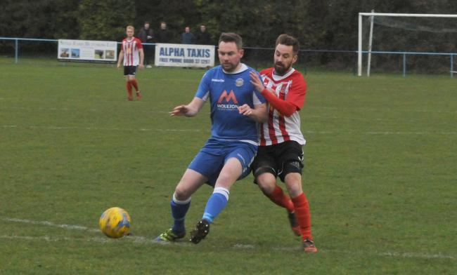 Football. Bradford Town (blue) v Bridgater Town (red). For Bradford is Simon Prangley and for Bridgwater is Jack Taylor.  Photo: Siobhan Boyle SMB2607/5.