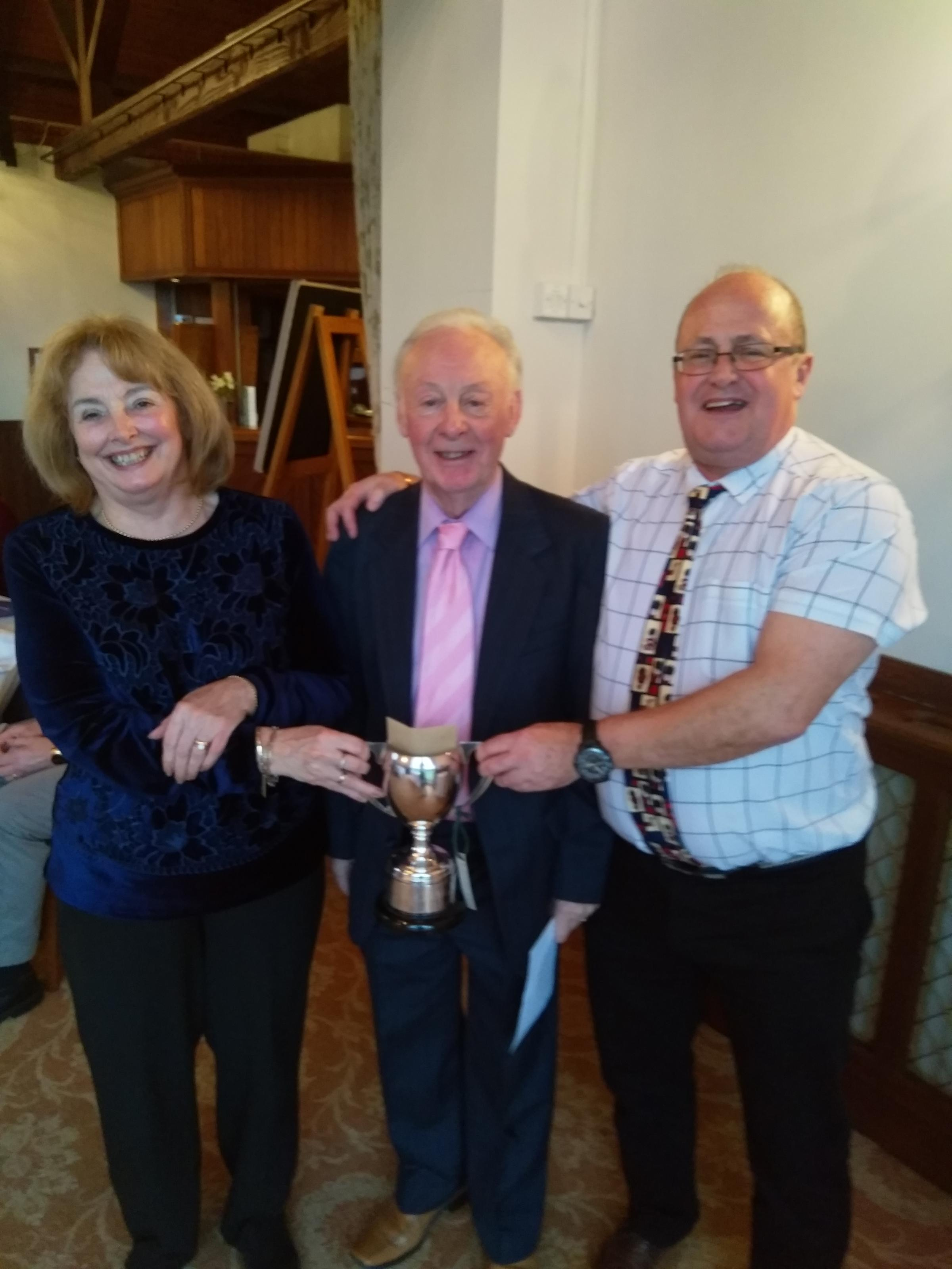 Sue Walters and Mark Blyth receive the mixed pairs competition trophy from Bradford on Avon Bowls Club president Michael Holbrow (centre)