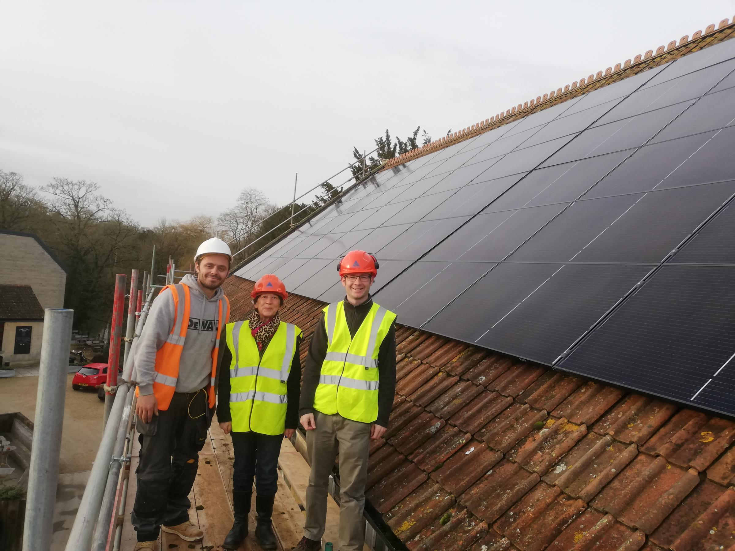 Bradford on Avon Mayor Cllr Alex Kay with solar panel installers at St Margaret's Hall